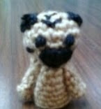 http://www.ravelry.com/patterns/library/pug-finger-puppet-2