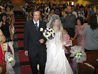 Mr Soon walking down the aisle with his daughter Cindy