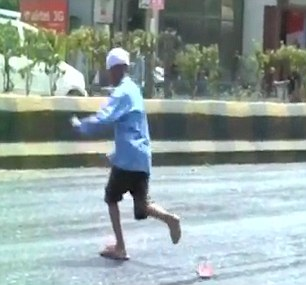Pedestrians lose their shoes as heatwave MELTS roads in India with temperatures hitting 51C (124F)