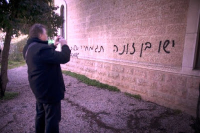 anti-Christian graffiti written in Hebrew on Baptist church