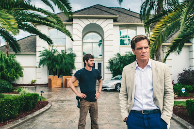Michael Shannon and Andrew Garfield in 99 Homes