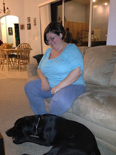 Michele watches as Coach chews on one of the nylabones.