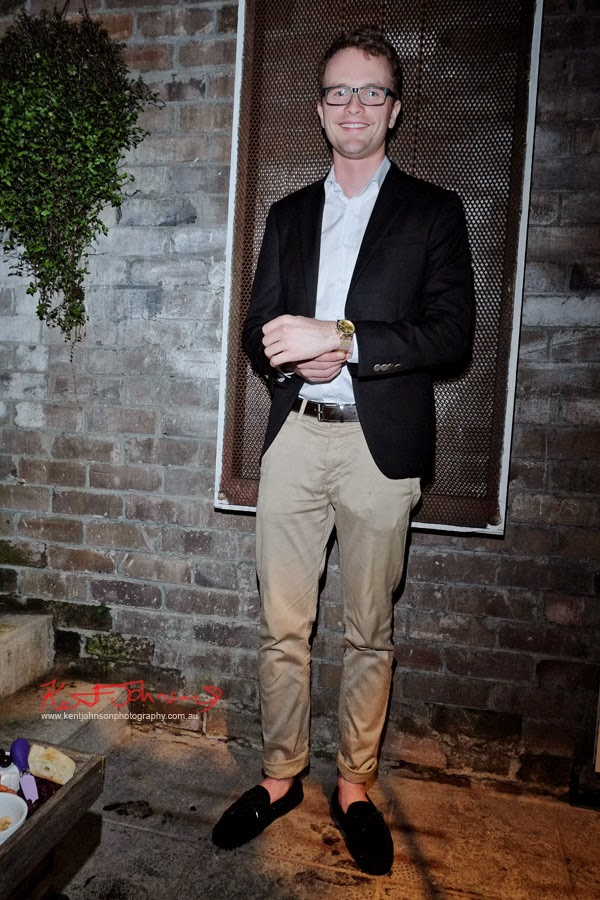 Theo, navy jacket chinos and loafers wearing the Chrono 'Sort of Black GOLD' TRIWA Watch, at BELANCÉ Sydney