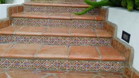 Saltillo tile walkway features hand-painted ceramic tiles on the risers.