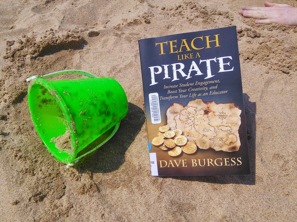 picture of book on beach with bucket