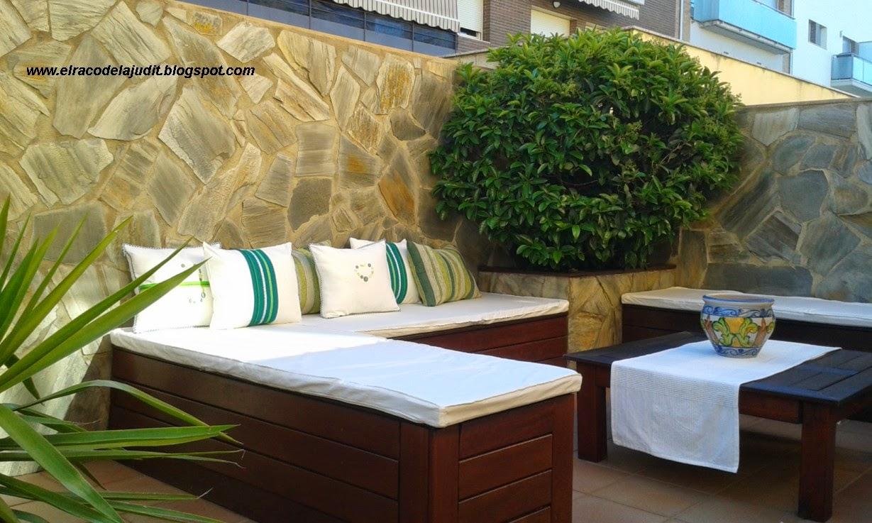 cojines con tonalidades verdes que combinan a la perfeccin con el blanco y la madera del mobiliario elaborados con telas de alta calidad botones