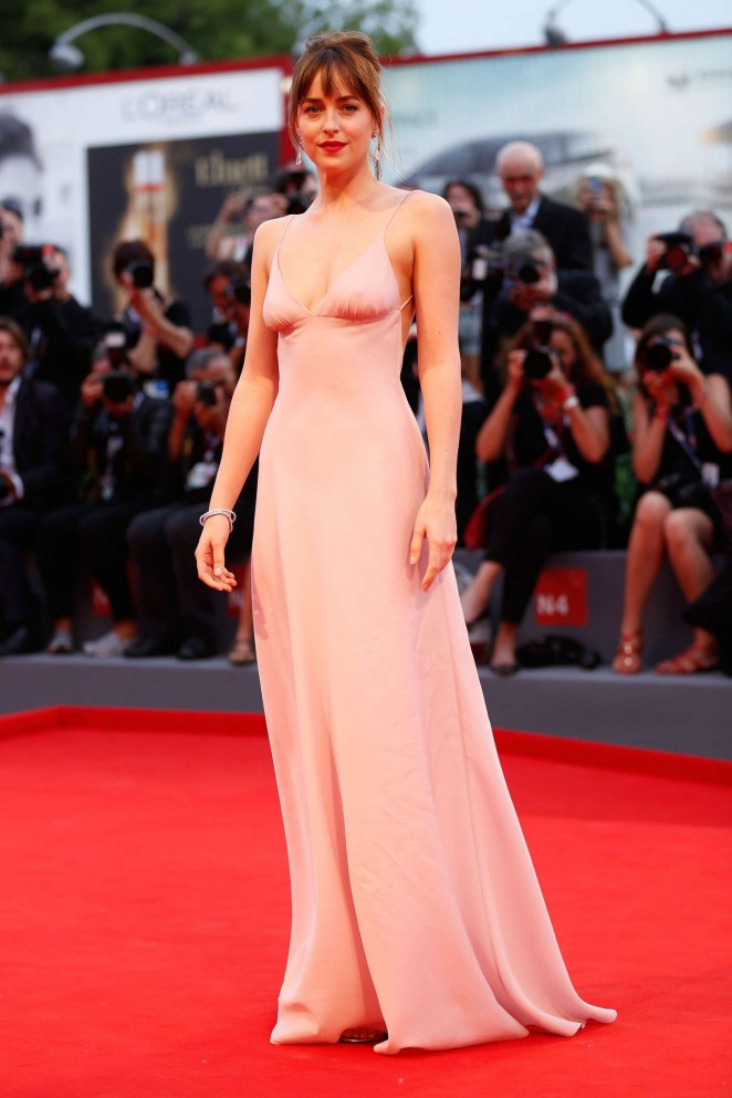 Dakota Johnson goes sexy in a slinky Prada dress for the 'Black Mass' Venice premiere