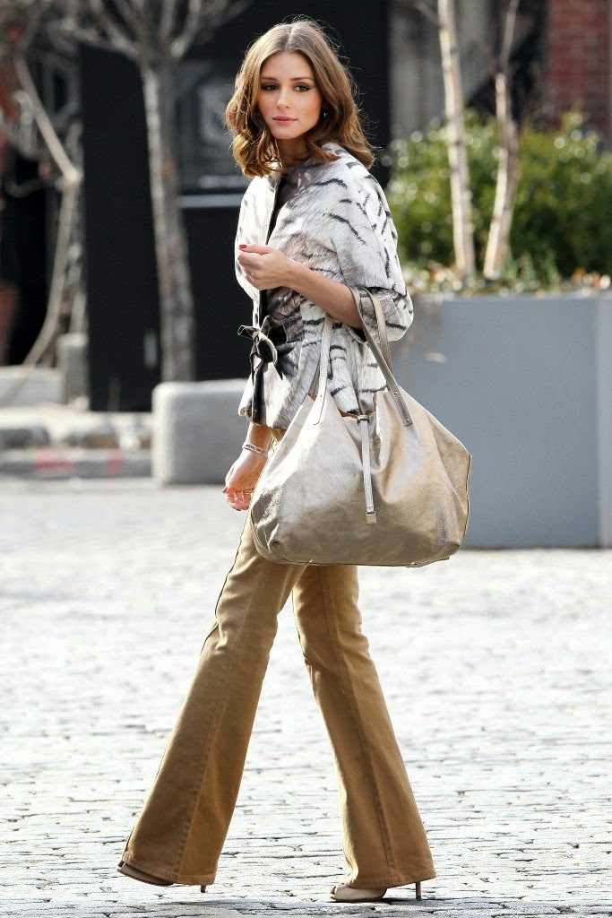 Olivia Palermo Easy to Copy Street Style 70s Style, Silver Tote, Flare Tweed Gold Pants and Animal Print Top - bestcelebsnaps