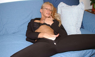 touching herself under her slacks