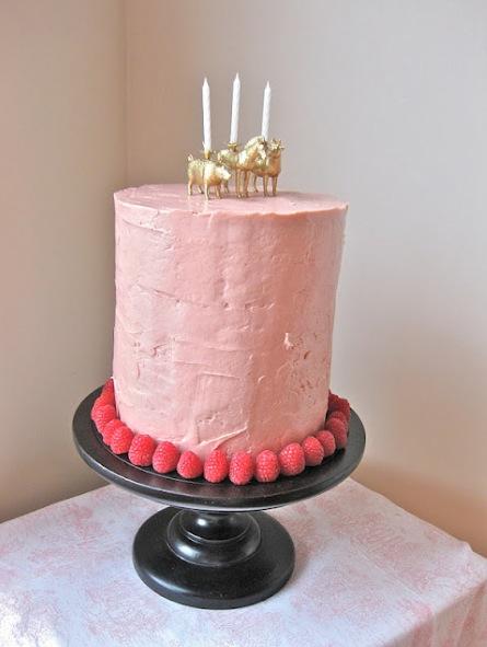 Fun candles on pink cake