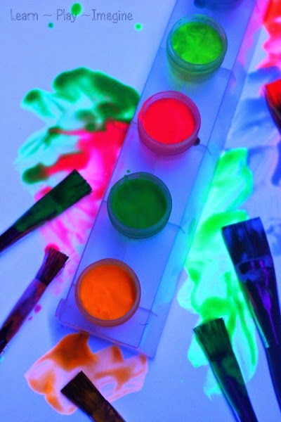 Simple to make glowing paint recipe in bold, vibrant colors.