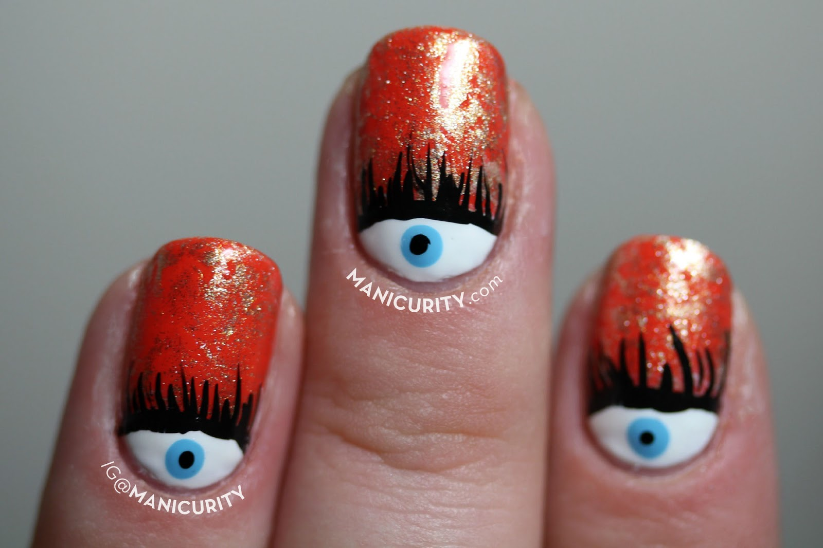 The Digit-al Dozen does The Terrific Twos! Celebrating our 2nd Anniversary with a freehand evil eye half moon manicure with saran wrap background | Manicurity.com @emmathea