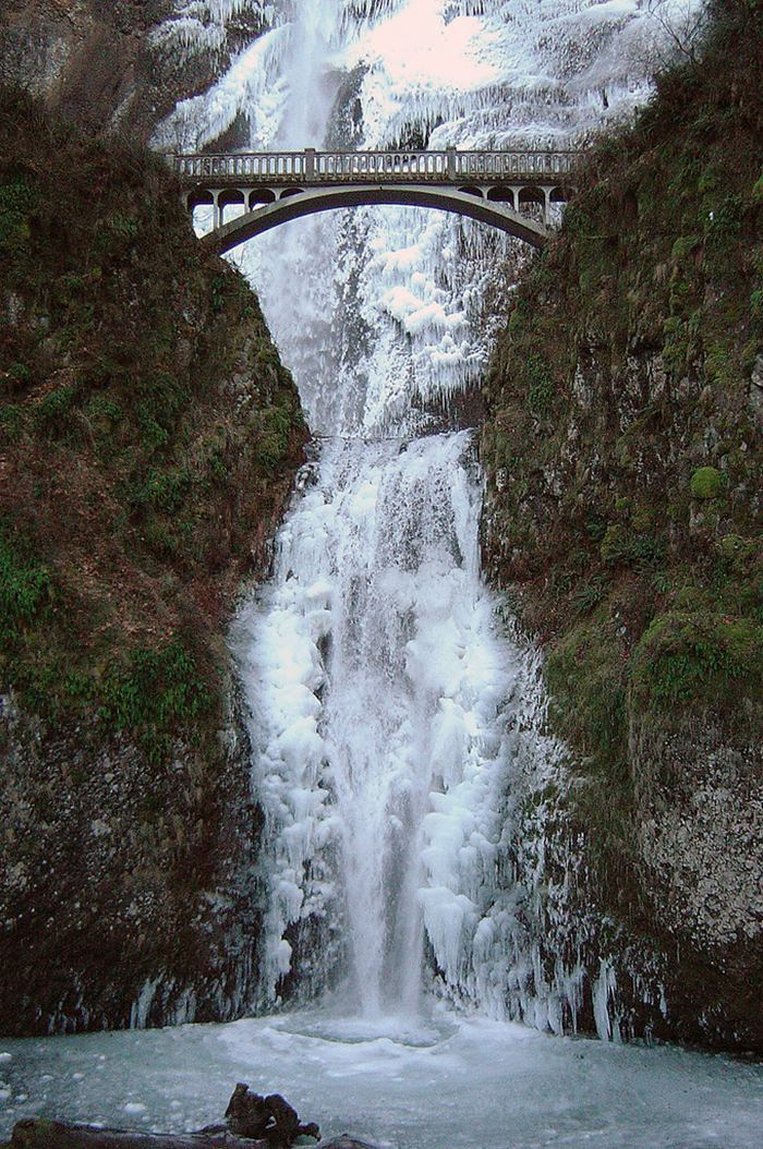 Multnomah Falls is a waterfall on the Oregon side of the Columbia River Gorge, located east of Troutdale, between Corbett and Dodson, along the Historic Columbia River Highway. The falls drops in two major steps, split into an upper falls of 542 feet (165 m) and a lower falls of 69 feet (21 m), with a gradual 9 foot (3 m) drop in elevation between the two, so the total height of the waterfall is conventionally given as 620 feet (189 m). Multnomah Falls is the tallest waterfall in the State of Oregon. It is credited by a sign at the site of the falls, and by the United States Forest Service, as the second tallest year-round waterfall in the United States. However, there is some skepticism surrounding this distinction, as Multnomah Falls is listed as the 137th tallest waterfall in the United States by the World Waterfall