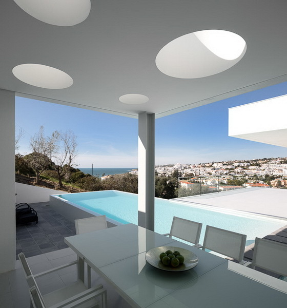White terrace table on Modern Villa Escarpa by Mario Martins