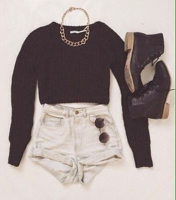 Crop jumper, shorts, boots, glasses and chain necklace