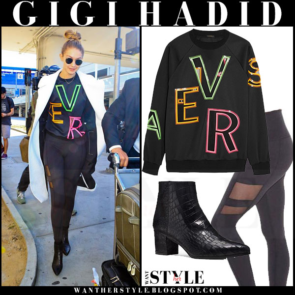 Gigi Hadid in white alc coat, black versace sweatshirt and black leggings what she wore model style