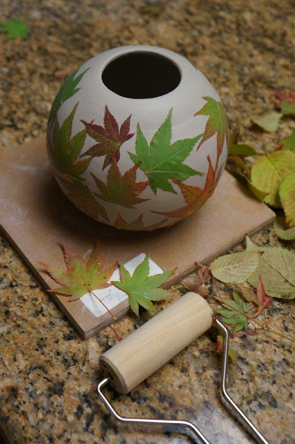 Beautiful leaf imprint ceramic pottery hand thrown vessel - in progress.