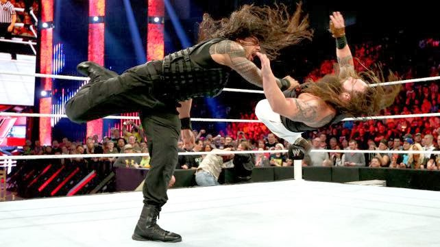 wwe roman reigns superman punch