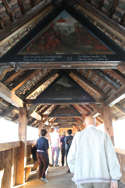 Restored interior paintings on Chapel Bridge in Lucerne, Switzerland