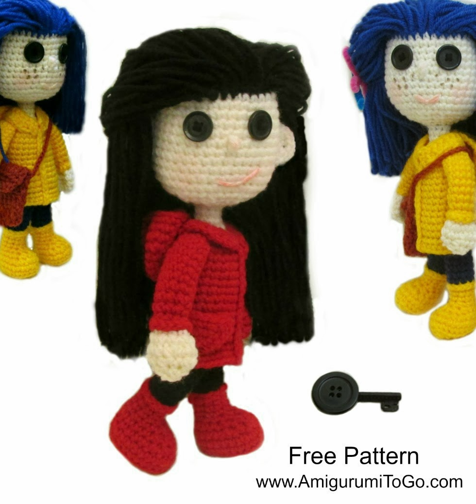 crochet doll with red coat and boots