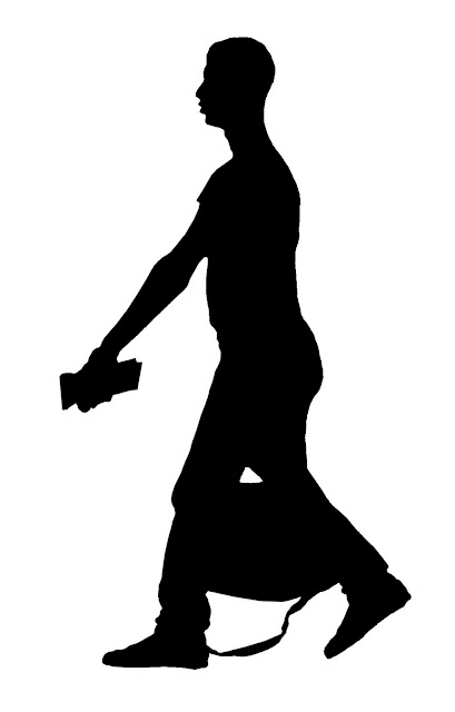 silhouette of young man with bag at airport