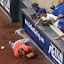 Mets fan tumbles onto field chasing foul ball (Video)