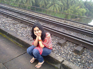 College girl waiting for train in chennai railway station.