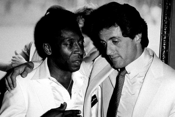 Sylvester Stallone gets pointers from football great Pelé during filming of 'Escape to Victory'