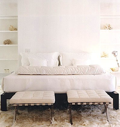 White leather and metal stools in a bedroom