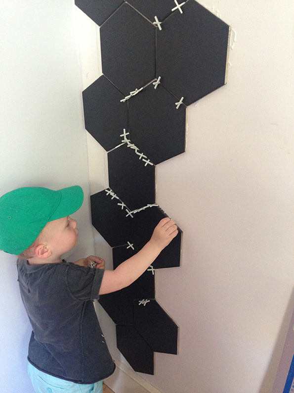 Boy helping with the porcelain hex tiles