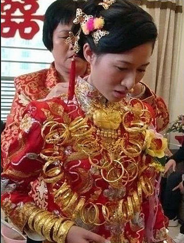 news article woman bling dynasty bride gets married wearing solid gold jewellery