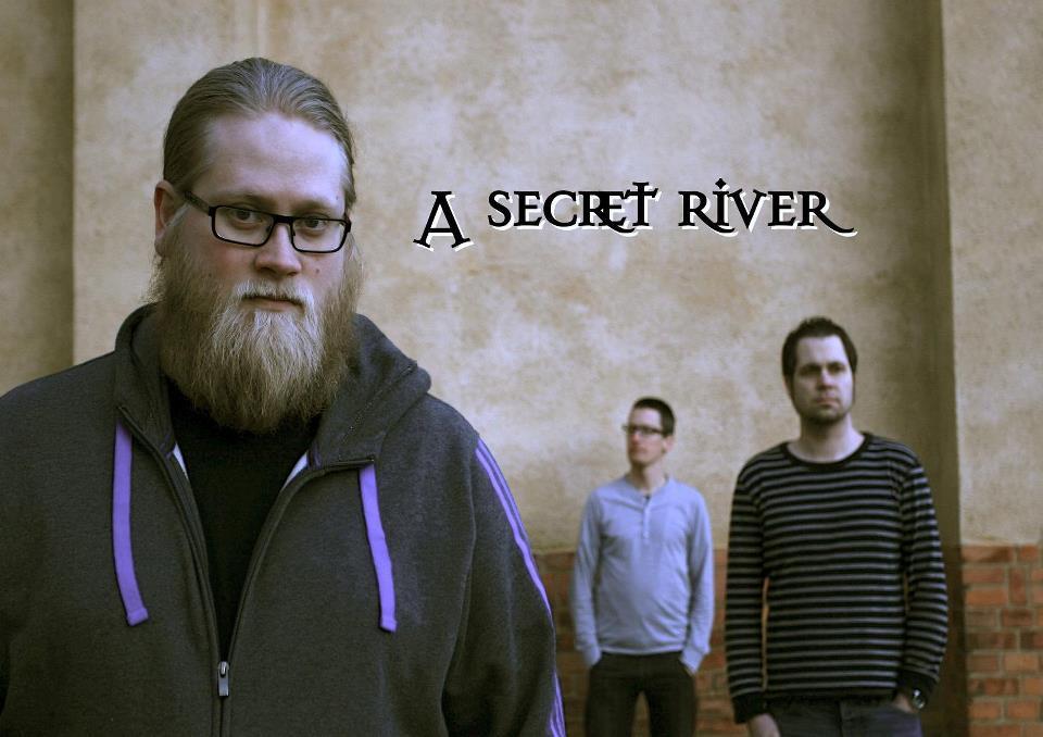 """""""A Secret River"""" é uma nova banda sueca de rock liderada por """"John Bergstrand"""" (bateria, percussão e vocais) e """"Andreas Alov"""" (baixo e vocais). Começaram a criar musicas juntos a partir de 1995 quando se conheceram em Gothenburg. Inspirados pela música progressiva, laçaram em forma de EP suas primeiras composições em 2012, depois juntou-se a eles o guitarrista com influências folk """"Mikael Grafstrom"""" e o tecladista """"Bjorn Sandberg"""", assim lançaram seu disco de estréia em 2014, chamado """"Colours Of Solitude"""". Apreciem."""
