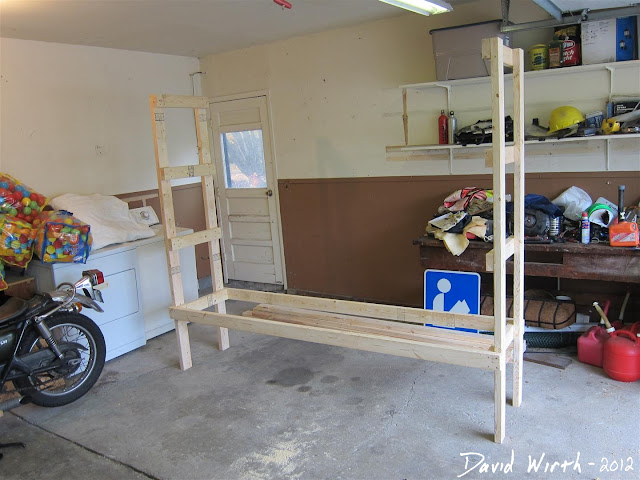 half way through building wood shelf, organize garage