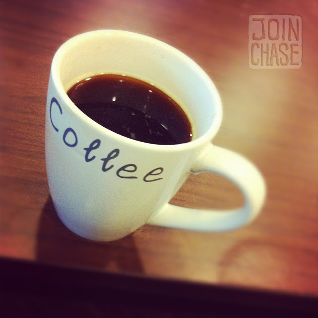 A cup of coffee on a table.