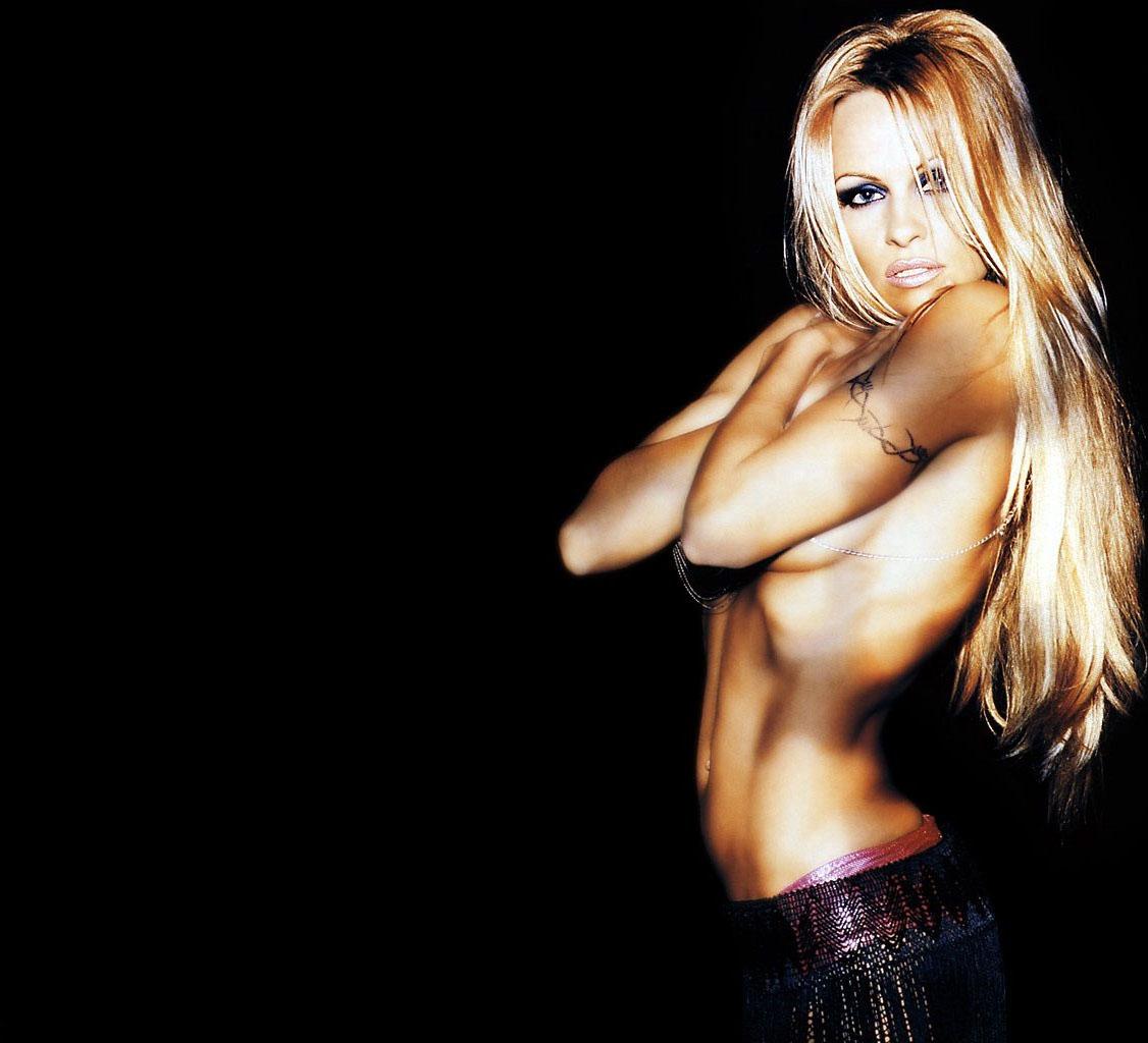 http://4.bp.blogspot.com/-PG6YDqRF3cs/TtaYk6qqu0I/AAAAAAAADj4/5RYhzIp4CiA/s1600/pamela-anderson-tattoo-back.jpg