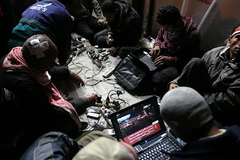 Anti-government bloggers work on their laptops from Tahrir Square. Despite government attempts to s