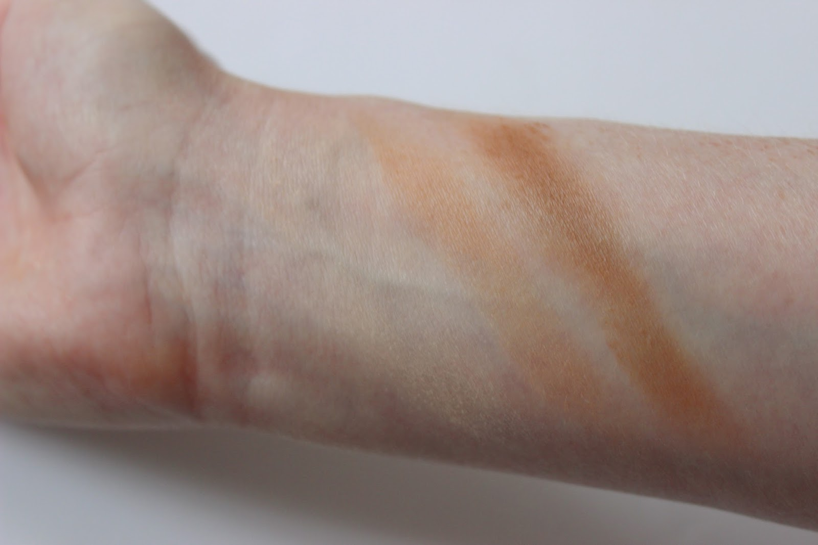 Too Faced cocoa powder foundation and soleil chocolate bronzer swatches