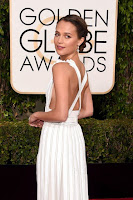 The Danish Girl star Alicia Vikander in white apron dress at the 2016 Golden Globe Awards Red Carpet photo