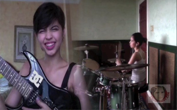 yaya dub plays drums and guitar