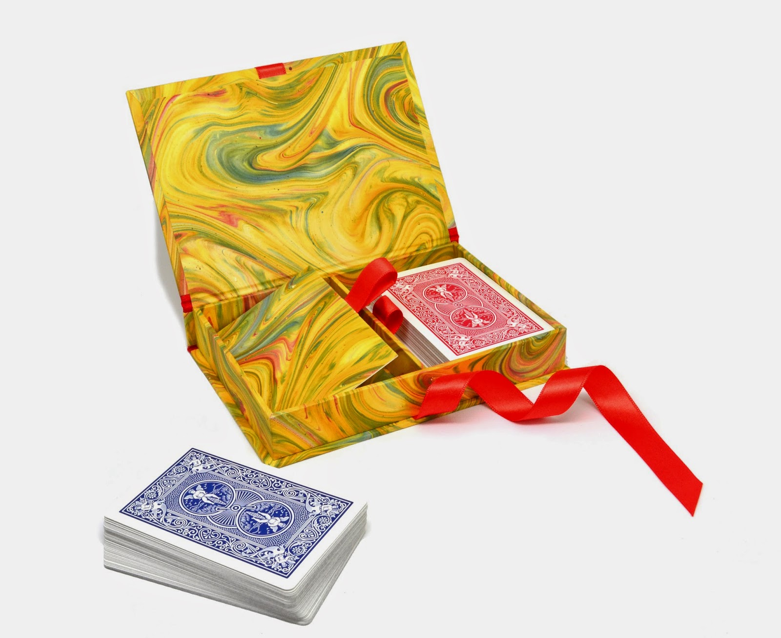 Parvum Opus provides custom made to order boxed playing card sets