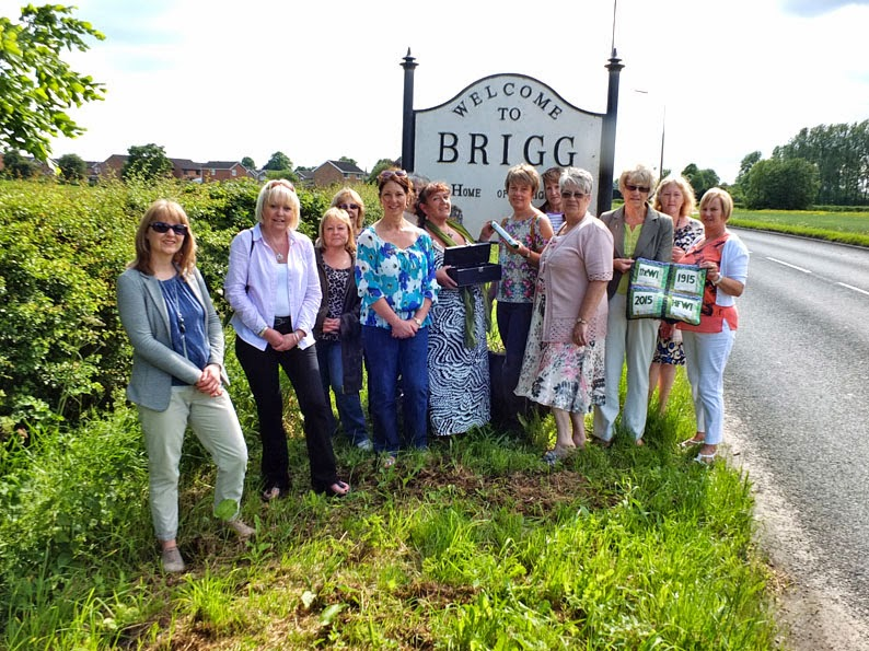 The Women's Institute Centenary Baton being handed over to Wrawby by Brigg at a ceremony beside the A18 - picture on Nigel Fisher's Brigg Blog