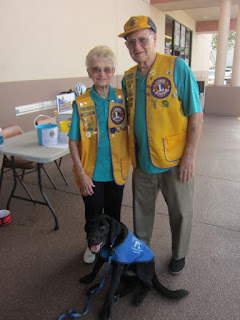 Coach with two of the Palm Harbor Lion's Club members.