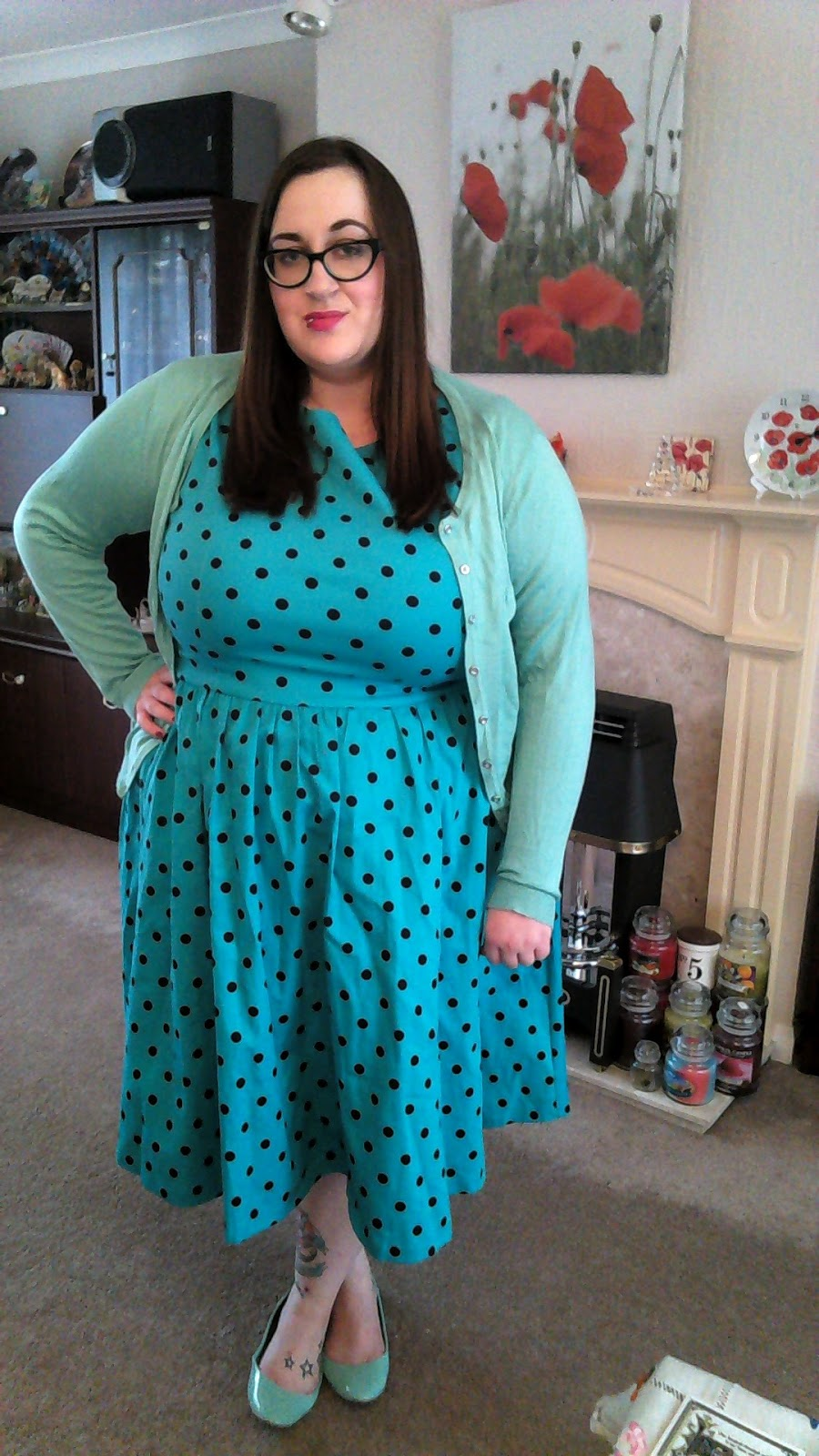 Fat plus size bbw girl (size 20/22) wearing a lindy bop turquoise Audrey dress