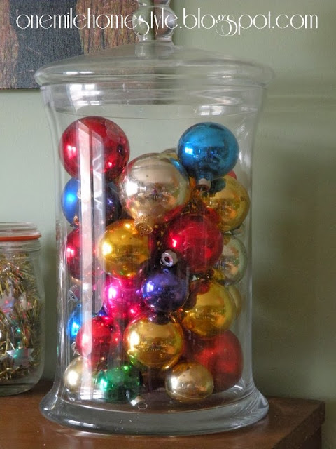 Glass jar of brightly colored vintage ornaments - Christmas decor