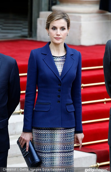 Queen Letizia of Spain listens to King Felipe of Spain as he addresses the media after their meeting with French president Francois Hollande at the Elysee presidential palace