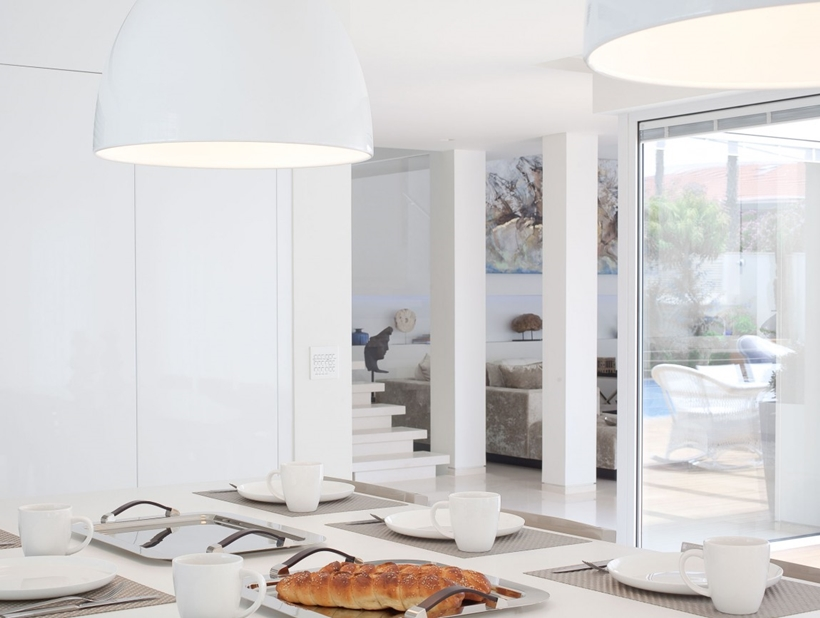 Dining table and White interior design in modern Sea Shell home