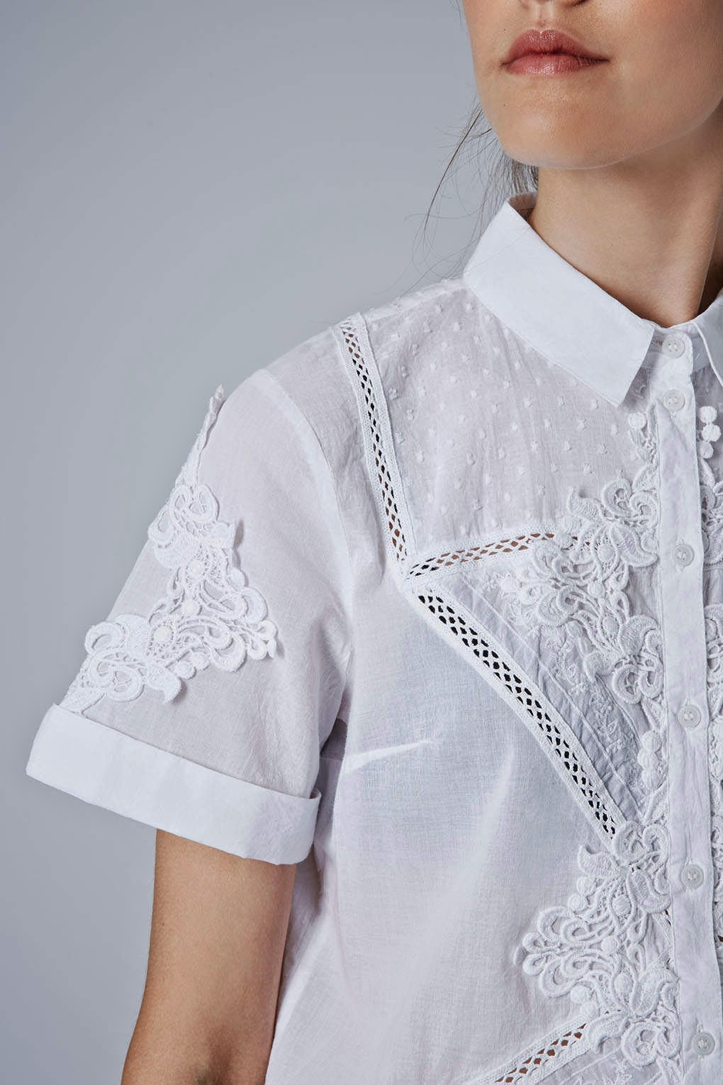 white embroidered short sleeved shirt