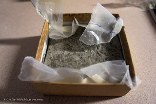 Small gift boxes make perfectly sized forms for concrete bottlecap coasters | A Crafty Wife