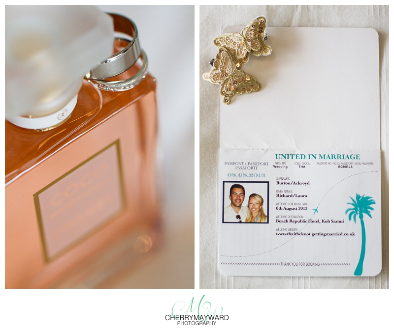 wedding details: parfume and wedding rings, invitations and butterfly hair clips