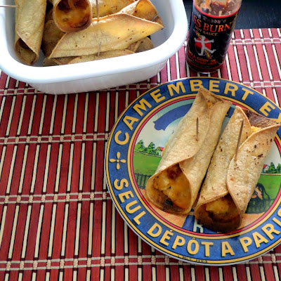 Baked Breakfast Taquitos:  Corn tortillas filled with scrambled eggs, bacon and cheese then baked until crunchy.